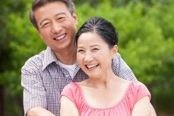 Asian happy senior couple in a park